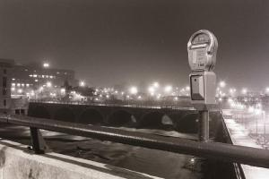 A portrait of a parking meter over the Genesee River in Rochester, NY